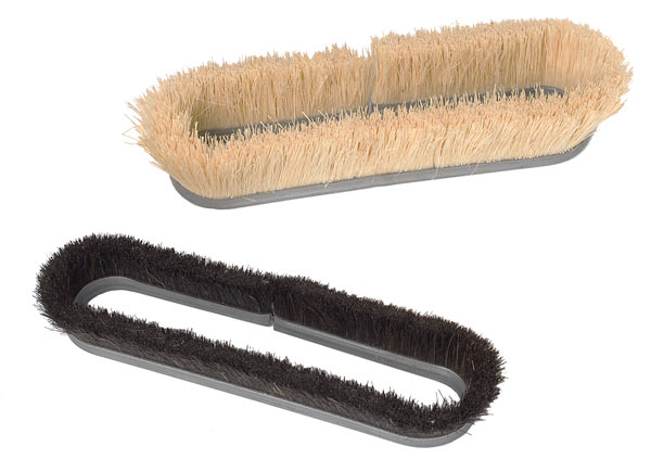 Oval cup brushes for grit and splash containment.